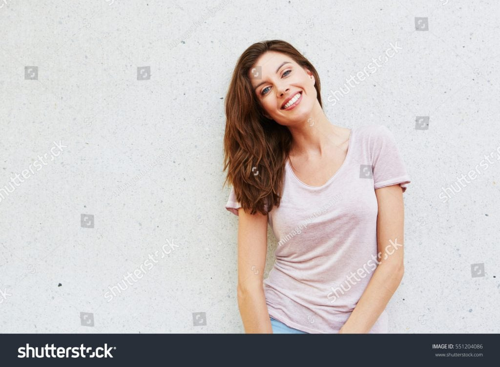 stock-photo-portrait-of-attractive-young-lady-smiling-against-white-background-551204086