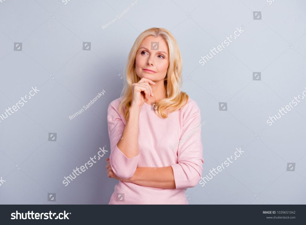 stock-photo-portrait-of-cunning-curious-emotion-expressing-pretty-charming-candid-with-long-wavy-curly-haircut-1039651042