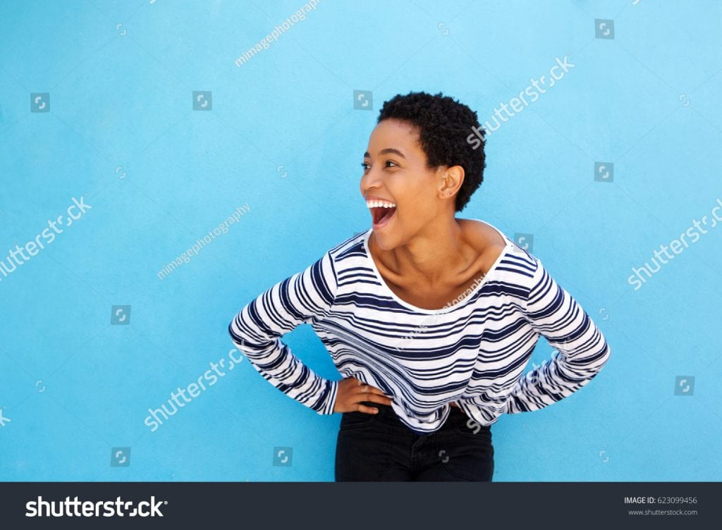 stock-photo-portrait-of-happy-young-black-woman-laughing-against-blue-background-623099456